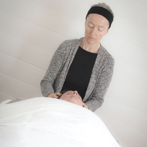 female giving facial Rejuvenation massage