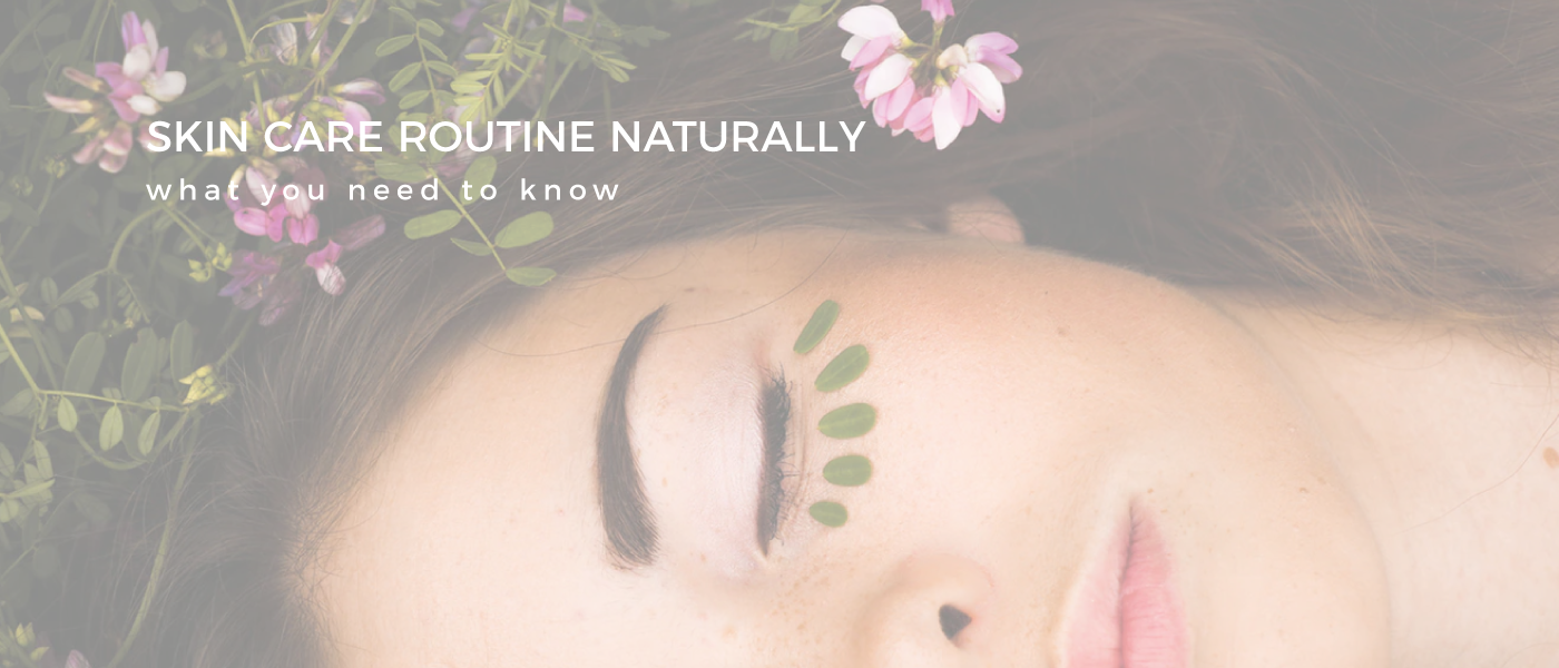 girl laying down with flowers in her hair skin care routine